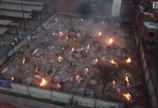 India, crematoriu amenajat într-o parcare. Foto: Print screen ABC News (Australia)